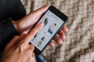 person-online-shopping-with-cell-phone